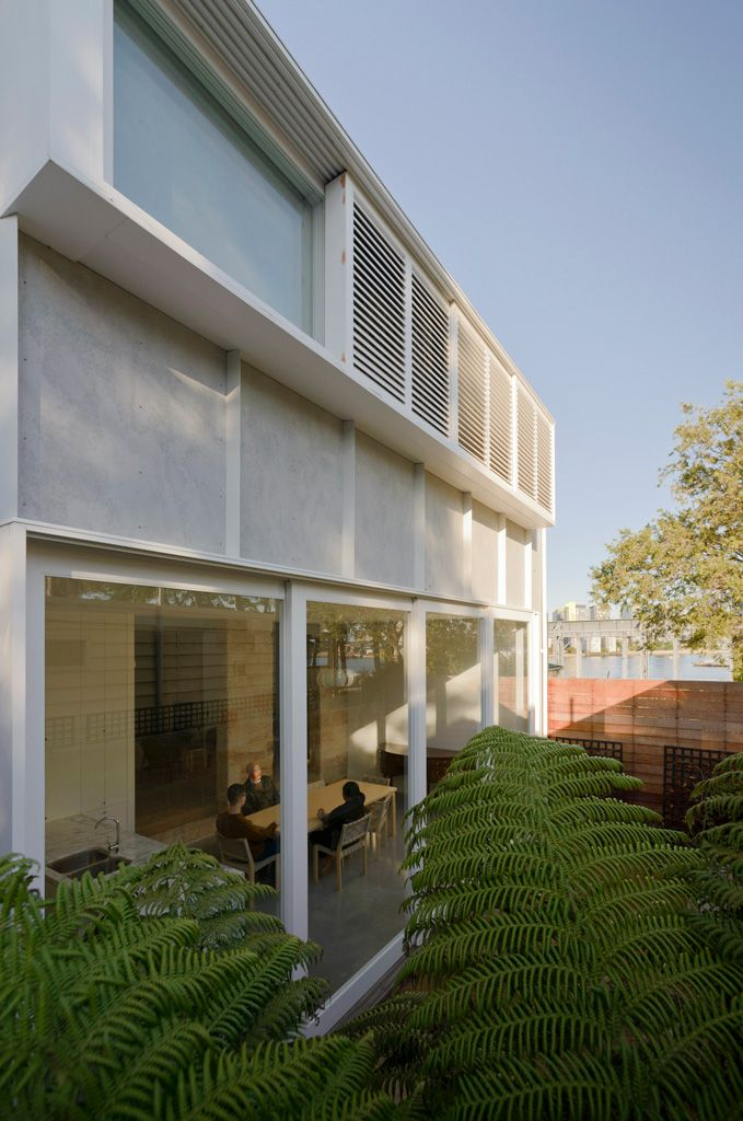 An intimate courtyard is connected to the new living space by over sized glass sliding doors.