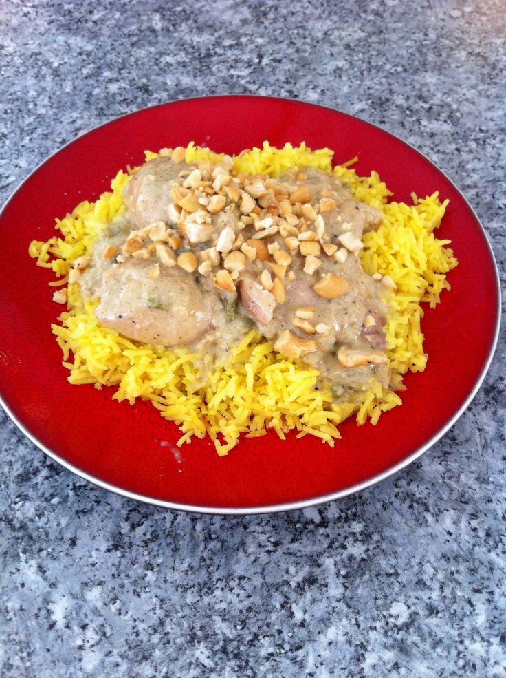 Coco milk chicken over yellow rice