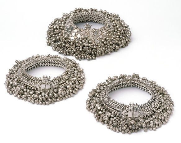 silver anklets with bells.