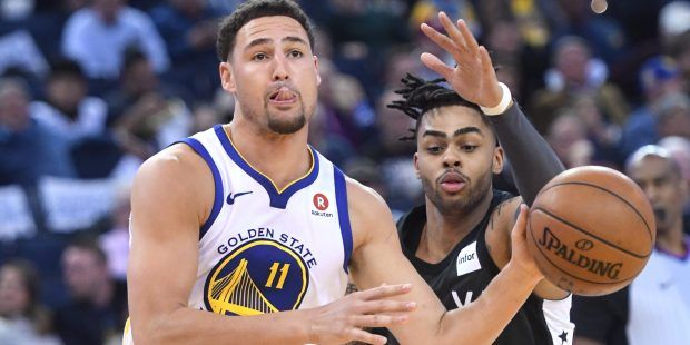 Golden State Warriors' Klay Thompson (11) gets past Brooklyn Nets' D'Angelo Russell (1) in the third period of their NBA game at Oracle Arena in Oakland, Calif., on Tuesday, March 6, 2018.. (Doug Duran/Bay Area News Group)