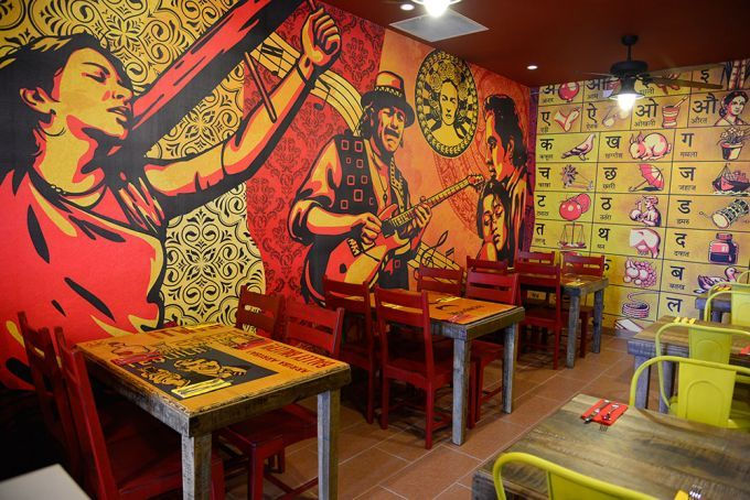 Mother India and friends adorn the walls of IndiMex's interior.