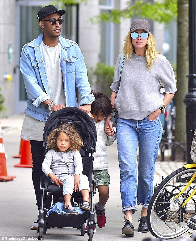 Quartet: Doutzen Kroes enjoyed a New York walk on Wednesday with her DJ husband Sunnery Gorré and their two children, six-year-old son Phyllon and two-year-old daughter Myllena