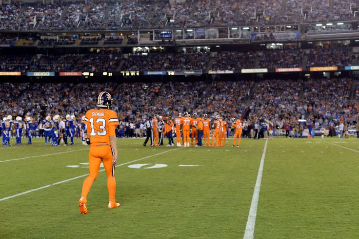 Broncos vs. Chargers:   October 13, 2016  -  21-13, Chargers   -      Denver Broncos quarterback Trevor Siemian (13) heads to the huddle after a timeout during the fourth quarter against the San Diego Chargers October 13, 2016 at Qualcomm Stadium.