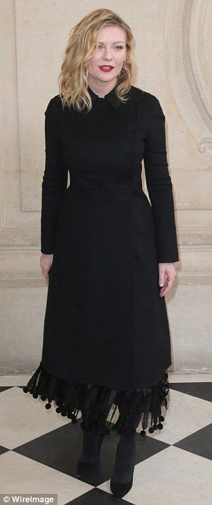 Star attraction: Not to be outdone, fellow actress Kirsten opted for a smart black tunic coat over a pleated, ankle-length evening gown