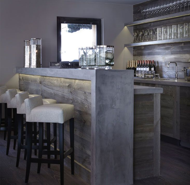 Bar idea we like  like the concrete for the bar front With kick plinth  lights under bar top