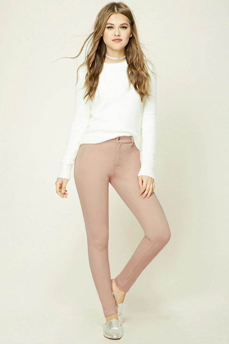 A pair of textured knit pants featuring a skinny leg, back patch pockets, a zip front, and belt loops.