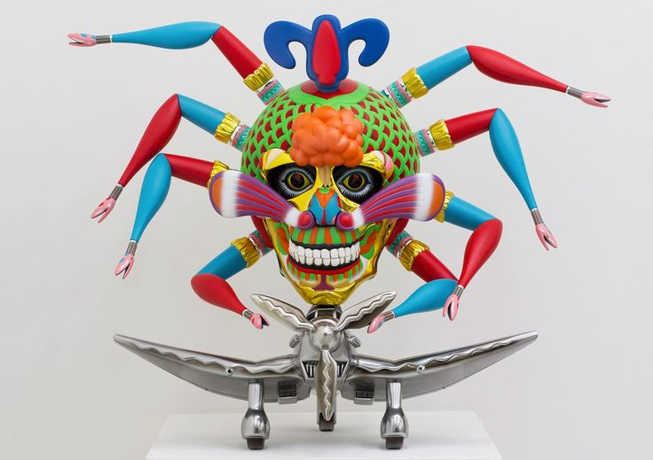 """Japanese artist Keiichi Tanaami explores canvases and sculptural pieces to create his surreal artworks. """"These works contain many motifs associated with Tanaami's childhood experience of war. Glowing, grotesque creatures personify bombs and the light of their explosions. Beams of emanating light are the searchlights of Japanese troops keeping watch for American bomber planes. The skeletal monsters that appear in his works represent war casualties, and at the same time function as ..."""