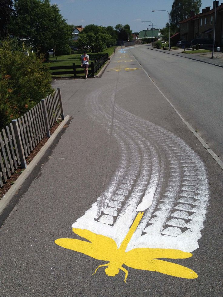 One might not think that parking lots, crosswalks, and other broad asphalt expanses would be particularly amenable to artwork, but for Montreaal-based artist and activist Roadsworth (aka Peter Gibson, previously) every white or yellow traffic paint stripe is a new opportunity. Although his work on t
