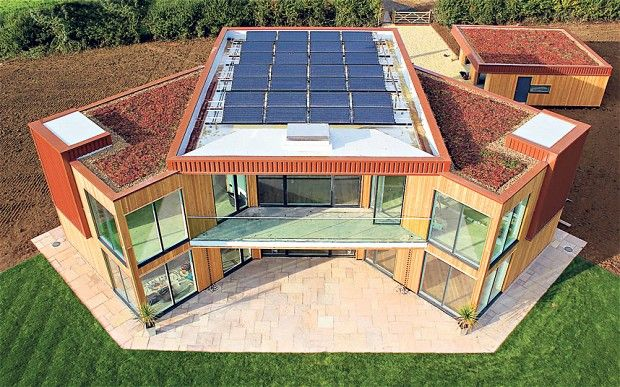 """Eco living: the Leicestershire home that powers itself - """"Traditional rooftop solar panels are joined by more experimental technology including """"solar walls"""", which preheat air before it is pumped into the home's ventilation system, and an """"Earth Energy Bank"""", which stores excess summer heat in super-insulated underground pipes, releasing it during the winter."""""""