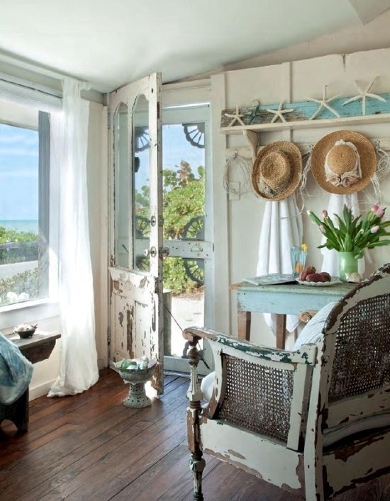 cottage  :) I LOVE Everything about this! where do I start?.. That ocean view!  the dark wood floors. the white chippy chair. that SWEET door. the colour scheme. white, light aqua, natural tan ....