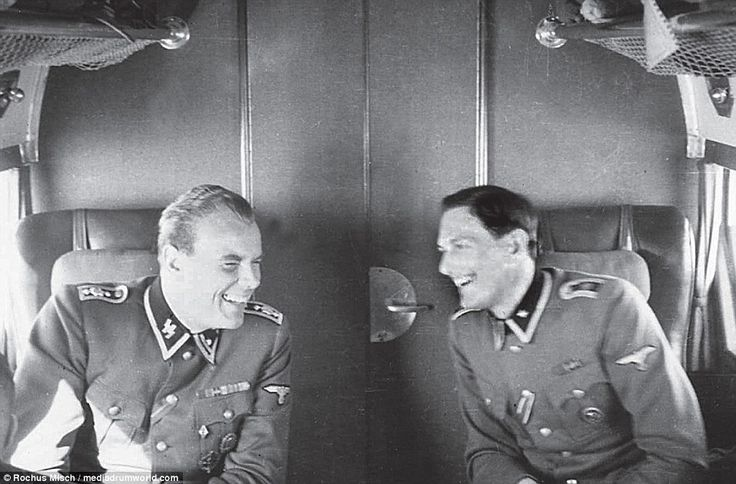 From the dark days of Germany: Rochus Misch (right) with Joseph Graf in a Ju 52 aircraft in a picture taken around 1941. ...