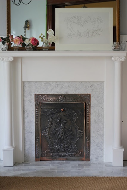 herringbone tile fireplace surround for the home