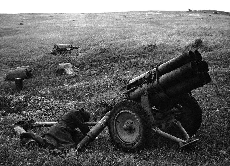 A German soldier lies sprawled against a Nebelwerfer after a bayonet attack in Tunis, Tunisia, on May 17, 1943. (AP Photo)