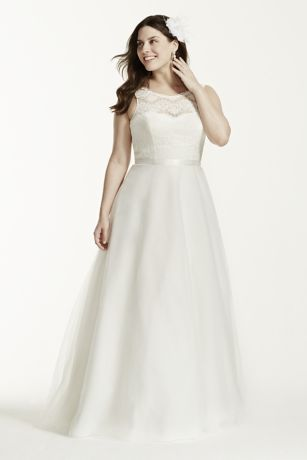 Your guests won't be able to take their eyes off of you in this soft and romantic illusion lace and tulle gown!  Illusion boatneck and lace bodice.  Sweetheart neckline creates an ultra-feminine focal point.  Delicate lace back detail.  A-line tulle skirt is polished off with a removable ribbon.  Sweep train. Sizes 16W-26W.  Ivory available in select stores and online.