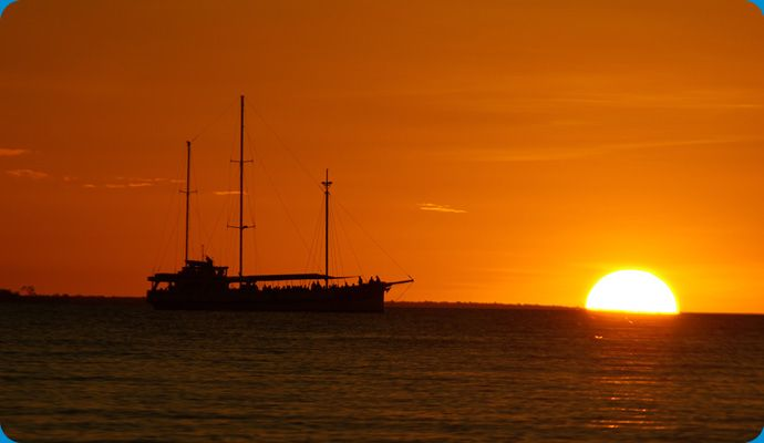 Take a sunset cruise on Darwin Harbour for a romantic end to the day. Northern Territory Australia.