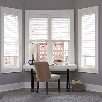 The large slat 2.5in Faux Wood Blinds shon in the pattern Embossed White
