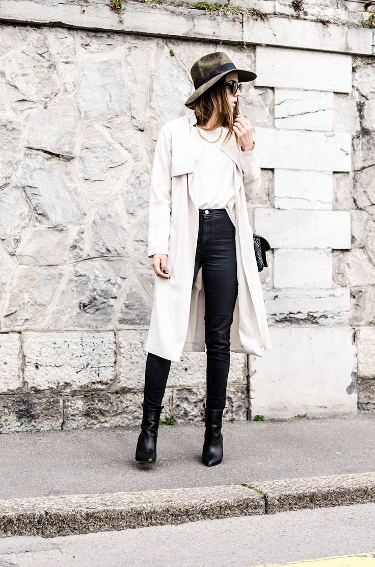 Street Style 2015:Alison Liaudat is wearing a creme trench coat from H&M, black American Apparel jeans and a pair of black Zara ankle boots