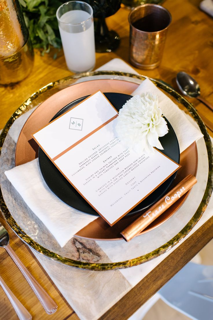 Industrial Glam! What is NOT to love about this stunning wedding place setting, complete with a marble placemat, gold rimmed charger plate, copper and black plates, a modern menu and a copper pipe place card?! Be sure to click the photo above to see the full gallery. I think you are going to love it. #sandiegowedding #brewerywedding | Always Flawless Productions | A San Diego Wedding Planning & Design Studio