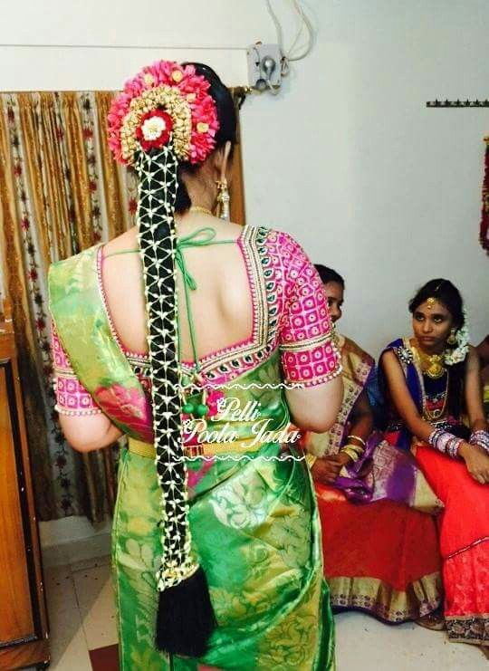 Green and pink combination...bride wearing net poolajada from https://m.facebook.com/PelliPoolaJada