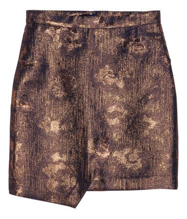 Dark blue/gold. Short skirt in jacquard-weave fabric with glittery threads. Attached wrapover section at front, concealed zip at back, and asymmetric hem.