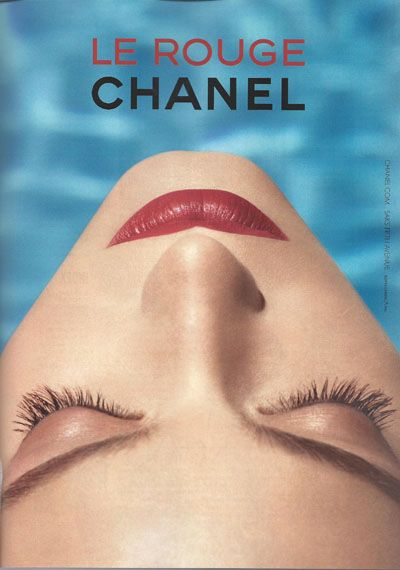 The pyramidic style of the ad and the centrality of the mouth.  Le Rouge Chanel lipstick.