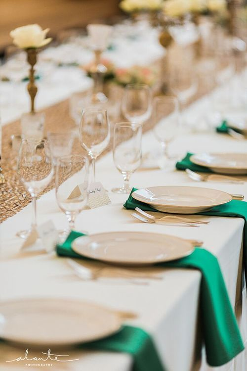 Gold-rimmed plates and silverware dress up this gorgeous emerald, gold and champagne table   #wedding #vintage