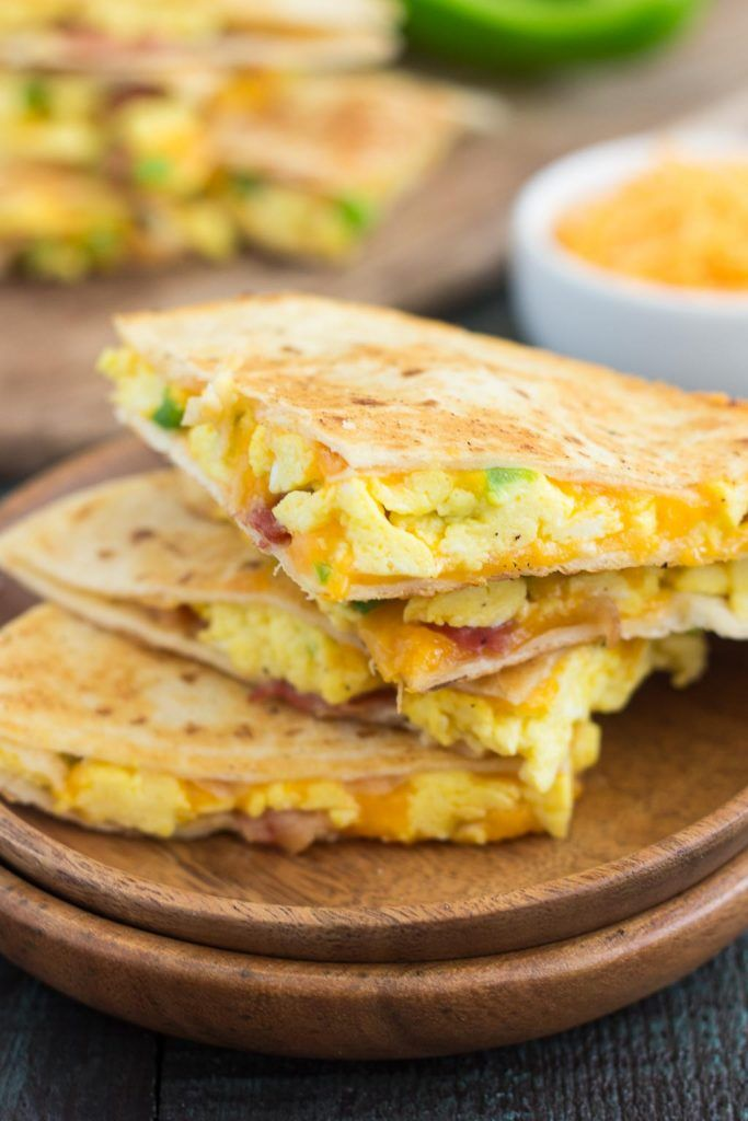 These Easy Breakfast Quesadillas are filled with fluffy, scrambled eggs, green peppers, bacon and cheddar cheeses, all enveloped between two crispy tortilla shells. It's an easy meal that's perfect for busy mornings!