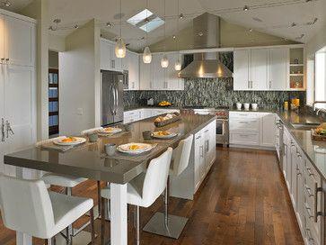 Beautiful kitchen with hardwood floors, large island, quartz countertops, tile backsplash.