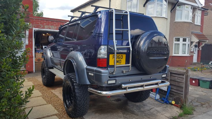 landcruiser prado /colorado rear ladder fitted to access quick release roof bars.