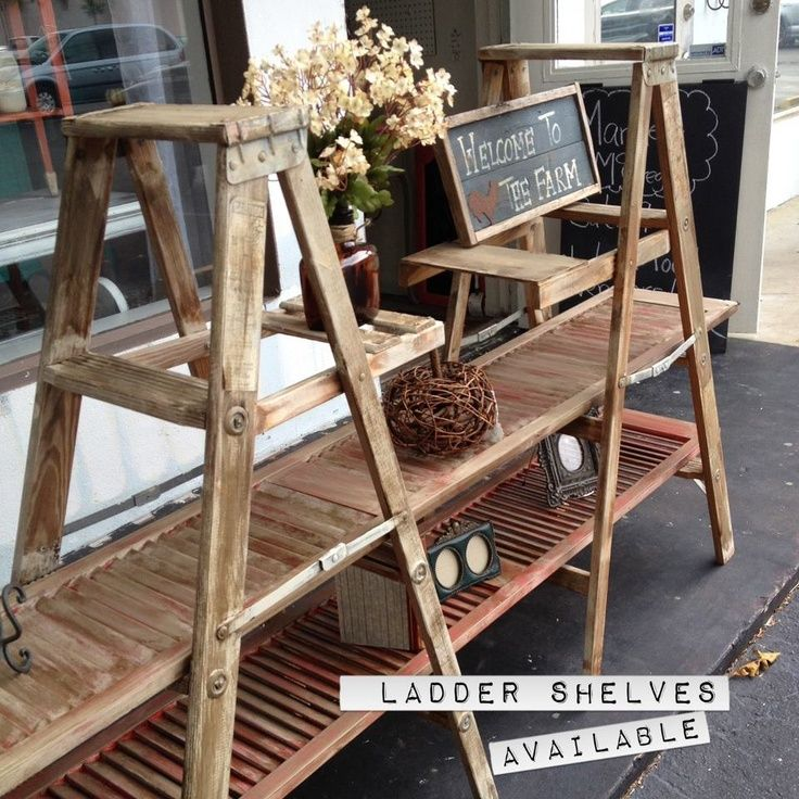 Display shelves created with shutter doors and ladders - good idea for a craft fair display