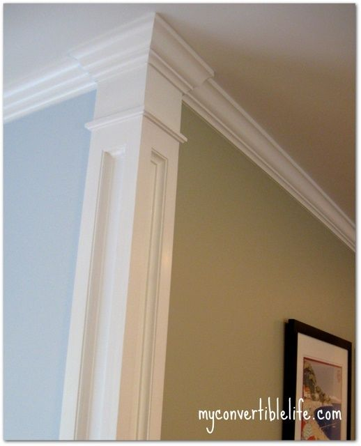 Add trim work at the corner of the room to create a column effect. It's a great touch that helps separate the rooms, and wall colors, without taking up any real space. Lower stairway?