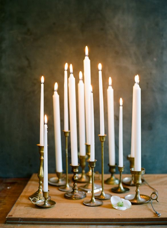 Romantic lighting with taper candles in brass candlesticks | Ali Harper