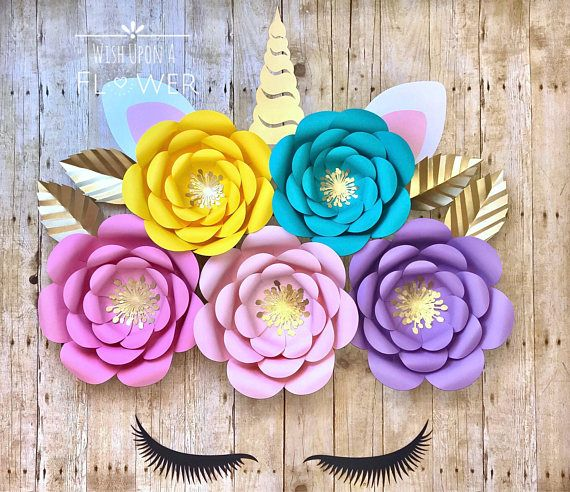 Unicorn flower decorations, these are a perfect focal point to go with your unicorn theme! This set looks great as a backdrop for a dessert table for your birthday party, baby shower or any unicorn themed party. It would also look great in a nursery. This listing includes: 5