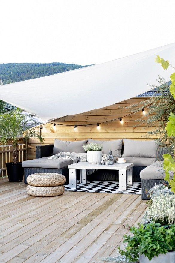 Seating area under an awning with string lights