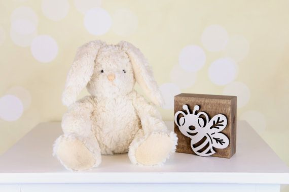 Bee-utiful! This modern, graphic bee wall plaque is whimsical and fun for a baby nursery or child's room. It will look great sitting on a shelf or