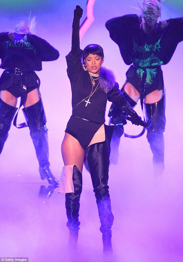 Great body of work: The star took to the stage in a black leotard with thigh-high boots