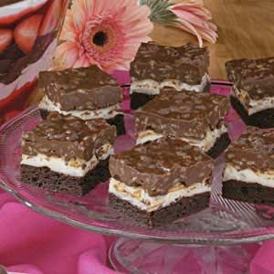 """Brownie Mallow Bars Recipe. From Lees Summit, Missouri, Stacy Butler notes, """"These yummy bars are a hit wherever I take them."""" A brownie mix streamlines assembly of the chewy bars, which are topped with mini marshmallows and a decadent layer of chocolate, peanut butter and crisp cereal."""