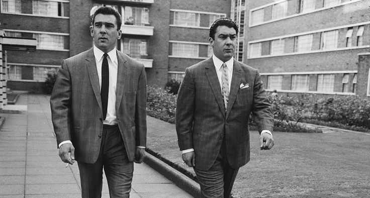 Twin brothers and organised crime bosses Ronnie and Reggie Kray in Cedra Court, off Cazenove Road in northeast London, 3rd August 1964. (Photo by Terry Disney/Express/Getty Images)