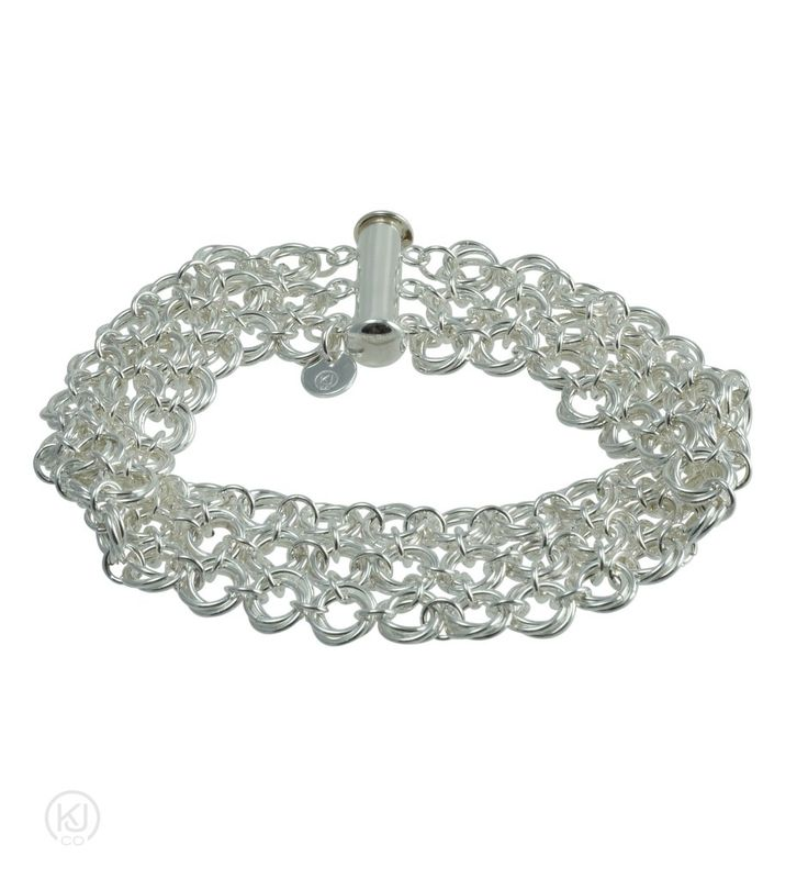 """Rosabella Love Knot – Cuff Bracelet – Taking it to the next level with this captivating Cuff style bracelet. Adds that sassy statement to any outfit. This Cuff Bracelet style is the ultimate statement of love with three connecting rows of endless love that is 2cm or 0.8"""" in width. Crafted by hand, each individual ring was coiled, cut and woven together to create this enchanting express of eternal love. Pair it with the Rosabella Love Knot Necklace and Earrings for that added touch of…"""
