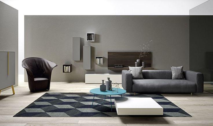 Contenere, esporre, nascondere.  Queste tre caratteristiche si racchiudono in questa zona giorno, diversificata nei colori, ma concepita in originalità. Completa la composizione il divano moderno DIS, realizzato in massello con tessuto nuvolato grigio. Che ne pensi dell'arredamento minimalista? Ti piace?