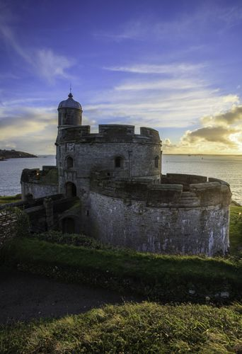SETTING SUN AT ST MAWES CASTLE. Cornwall, England
