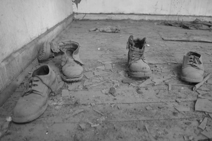 abandoned boots & shoes in old train station.