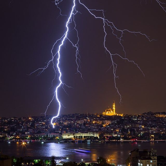 """7,401 Likes, 40 Comments - BBC News (@bbcnews) on Instagram: """"8 MAY: A ferry is seen crossing the Golden Horn as lightning strikes in front of the Fatih Mosque…"""""""