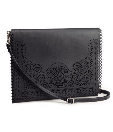 Cut Out Decoration is still going to be Popular in the Coming Seasons make a worth while investment! - Black Leather look Clutch Bag from H available for £24.99