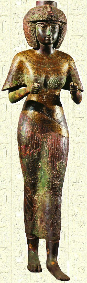 Queen Karomama wears a Mut vulture wrap skirt, like a sarong, over her pleated linen top. The wings of the bird are placed in such a way on the cloth as to seem as though Mut was behind the queen, envelopping her in its protective wings. The wing pattern, called Rishi by Arabic scholars, may have been embroidered. Divine Adorator of Amun, Karomama, 22nd dynasty.