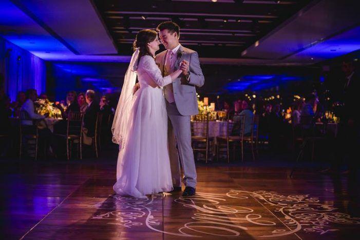 custom dance floor design, monogram wedding dance floor decal from Modern DC Newseum wedding by Holly Chapple Flowers, Michelle Lindsay Photography
