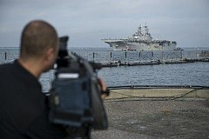 The amphibious assault ship USS Kearsarge (LHD 3) arrives at Naval Station Norfolk following Hurricane Maria relief efforts.
