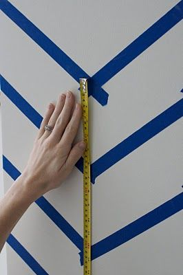 How to paint chervron stripes on a wall!  I totally want to do this.  On a small wall of course because I wont like it next year...:)