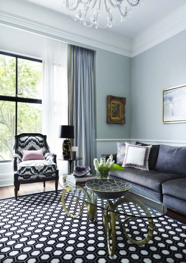 Gorgeous ripplefold drapery adds a modern touch to a traditional space.