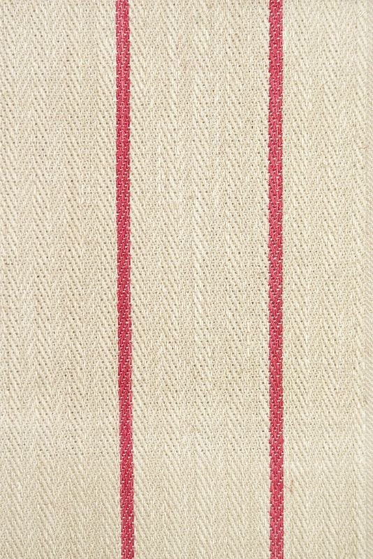 Camelford Striped Fabric Heavyweight light oatmeal cotton herringbone with thin poppy pink stripe.  Suitable for Drapes, Upholstery and Soft Furnishings.